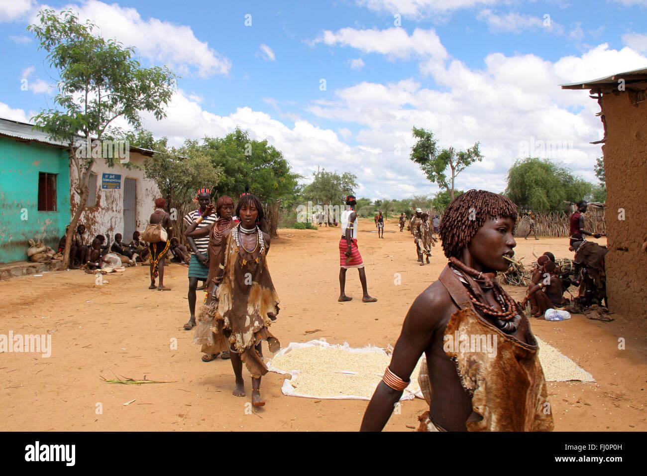 Hamer tribe women are walking in Turmi village, Omo valley, Ethiopia - Stock Image