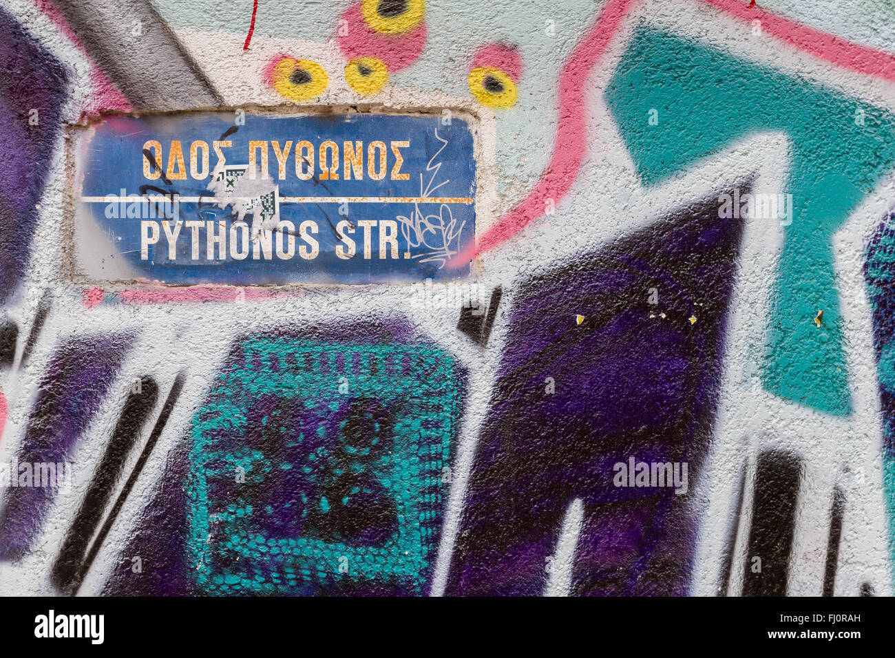 Nicosia, Cyprus - 18 February, 2016: Street Name Sign surrounded by Beautiful Street Art on Pythonos Street in Old - Stock Image