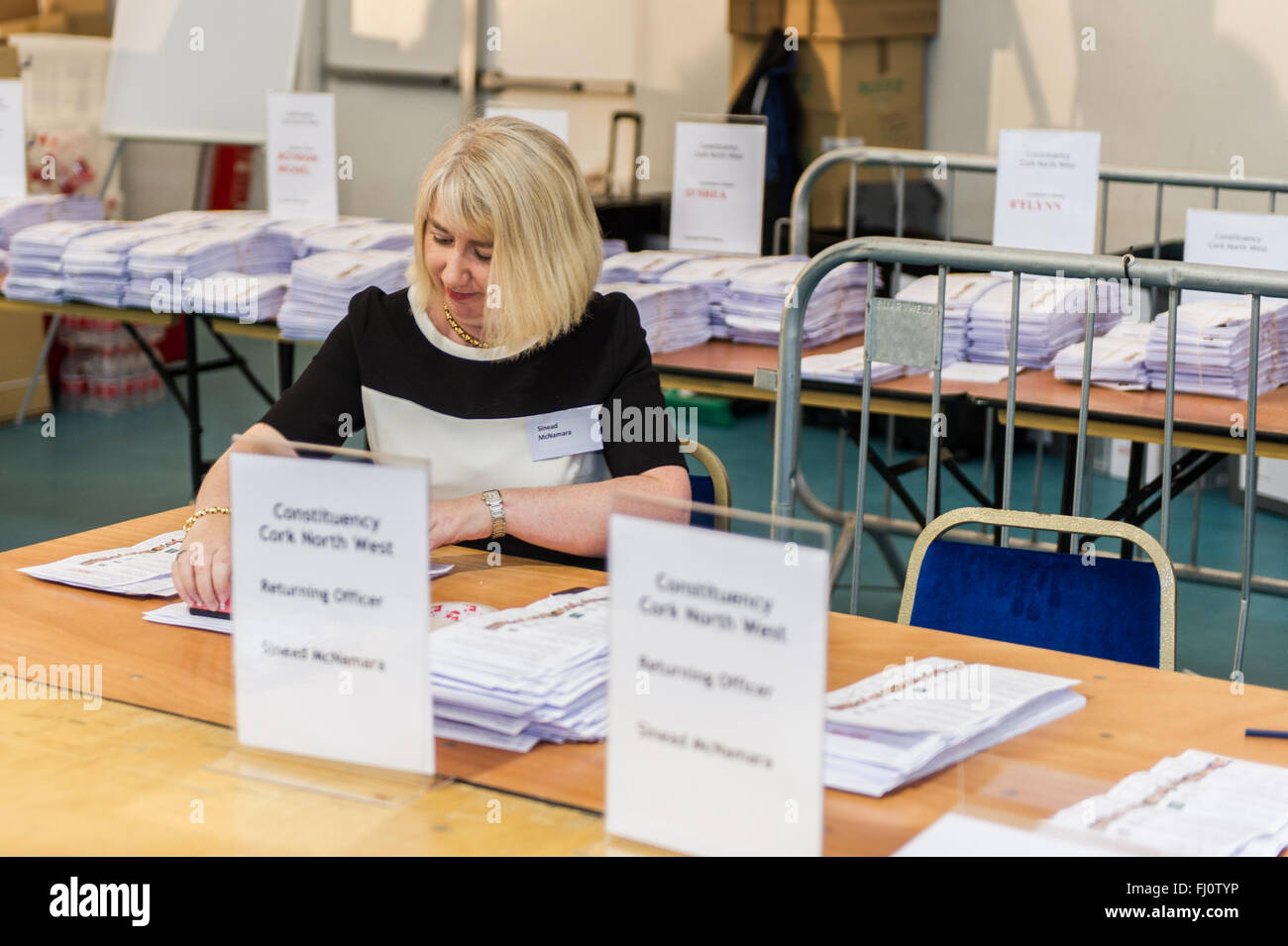 Ballincollig, Ireland. 27th February, 2016. Cork North West Returning Officer, Sinead McNamara stamps the spoiled - Stock Image