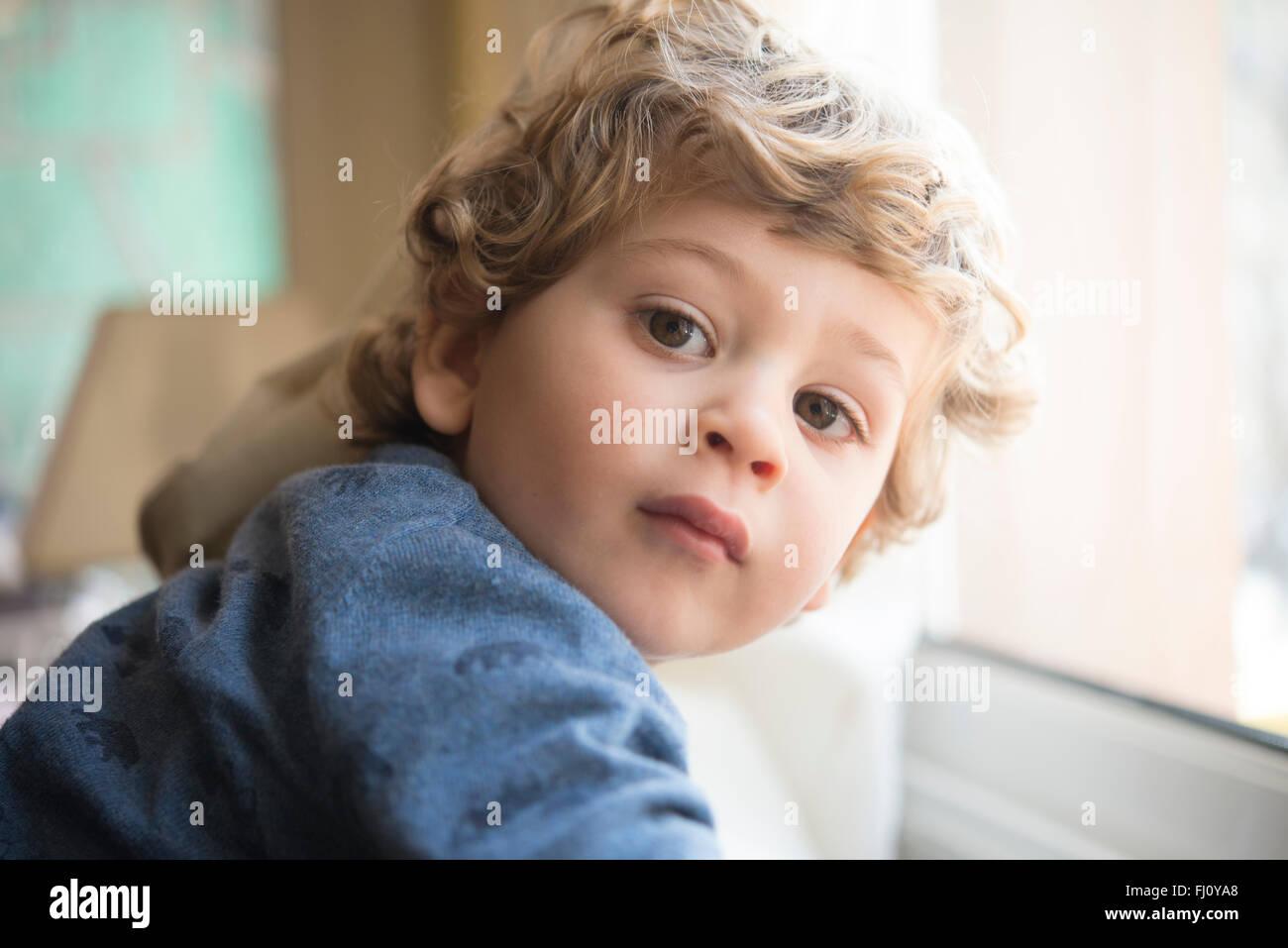 Portrait of little boy looking over his shoulder Stock Photo