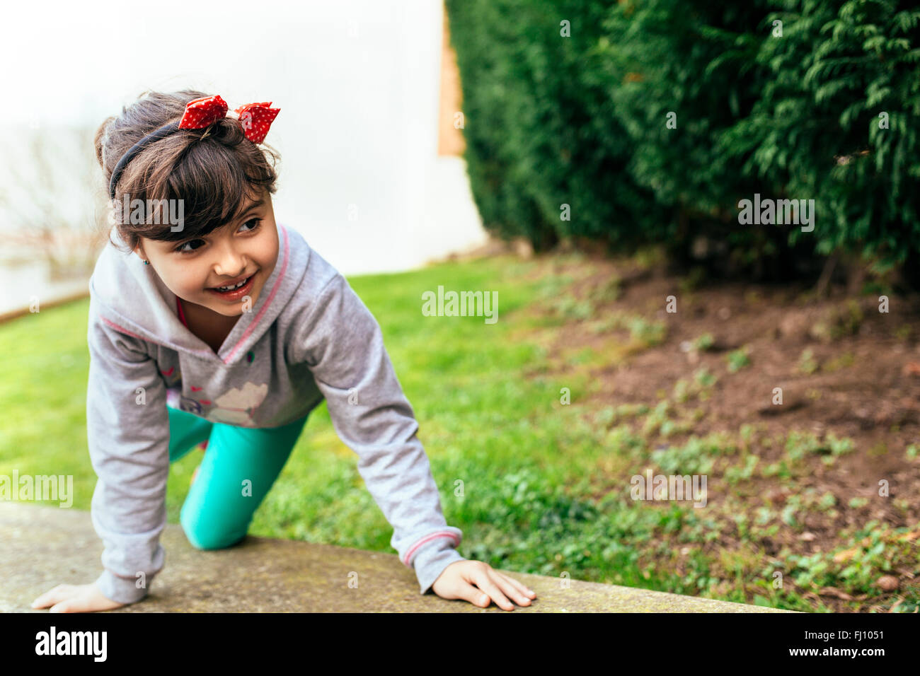 Portrait of little girl playing outside - Stock Image