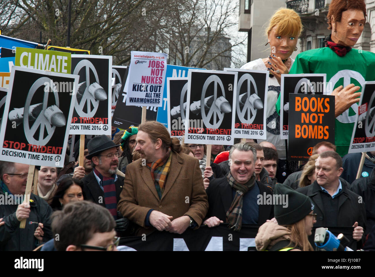 Protesters against Trident; they carry banners 'Jobs not nukes', 'Books not Bombs'. Scottish Nationalist - Stock Image