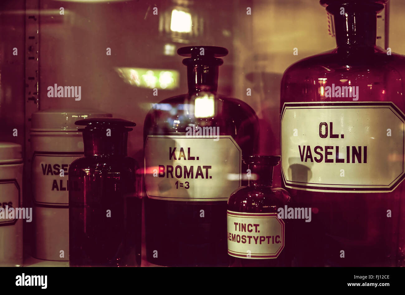 Old apothecary bottles in an apothecary cabinet Stock Photo