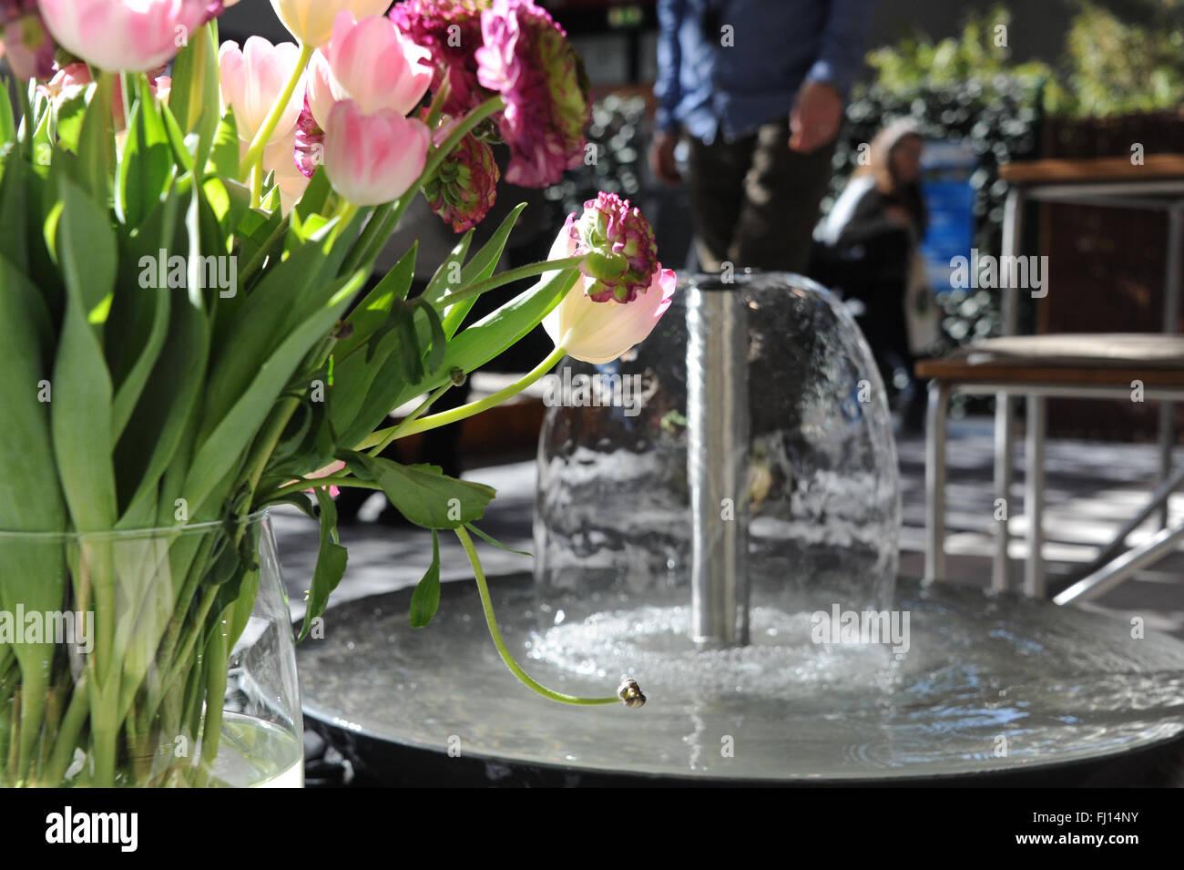 Munich, Germany. 26th Feb, 2016. A garden well and flowers cann be seen at the International Handcraft Fair IHM Stock Photo