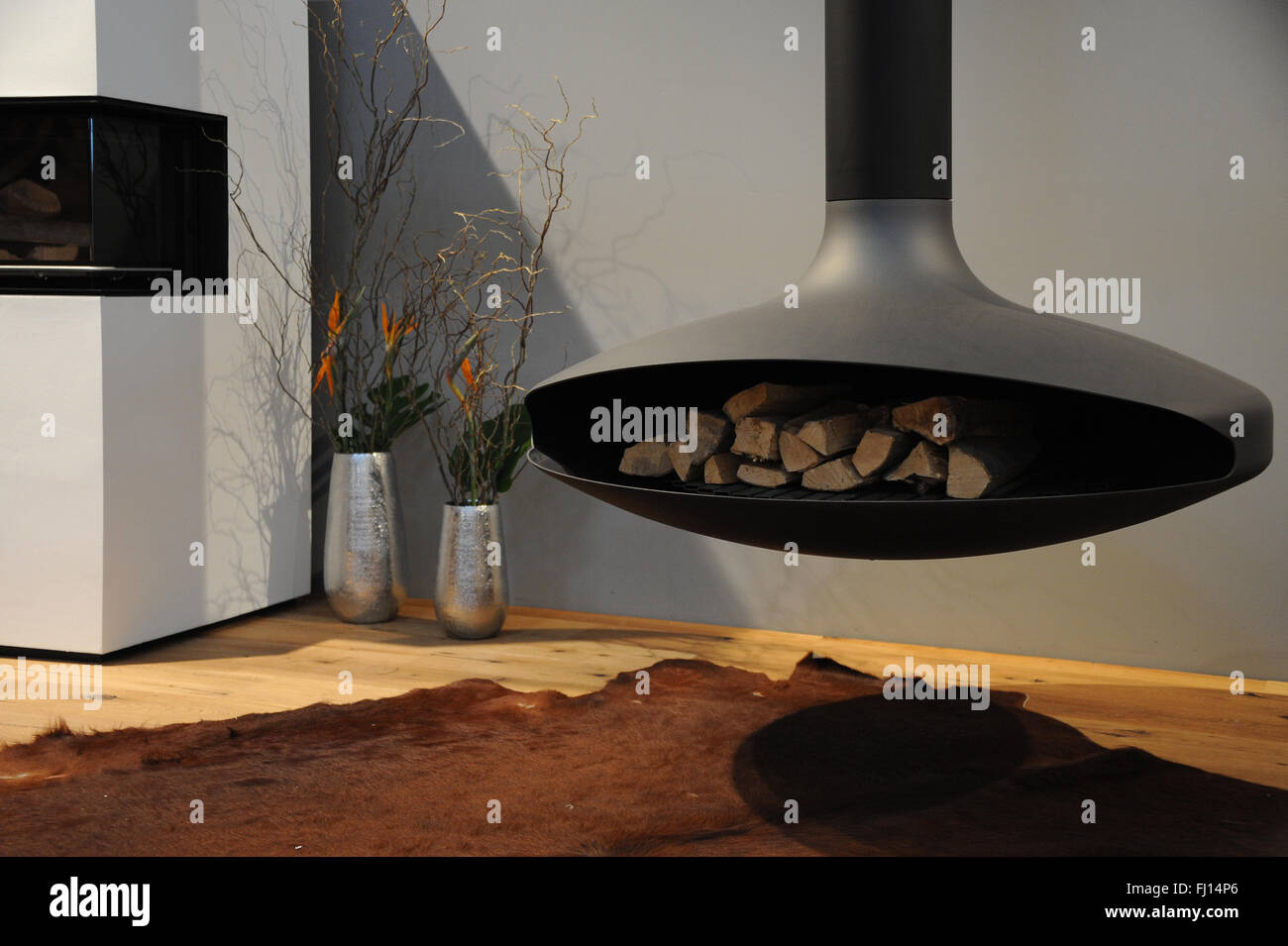 Munich, Germany. 26th Feb, 2016. A fireplace can be seen at the International Handcraft Fair IHM in Munich, Germany, Stock Photo