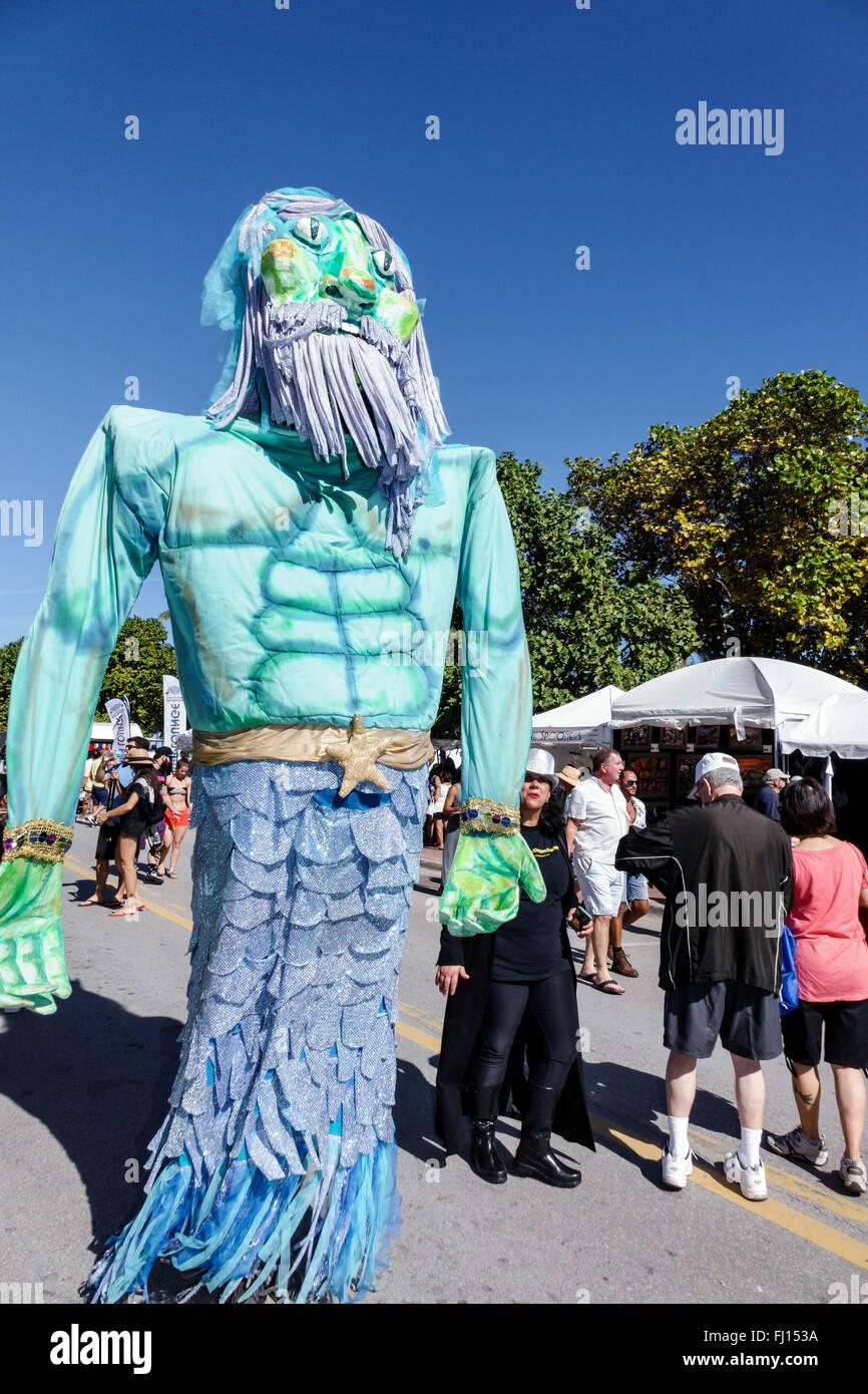 Miami Beach Florida Art Deco District Ocean Drive Art Deco Weekend annual event fair festival Neptune character - Stock Image