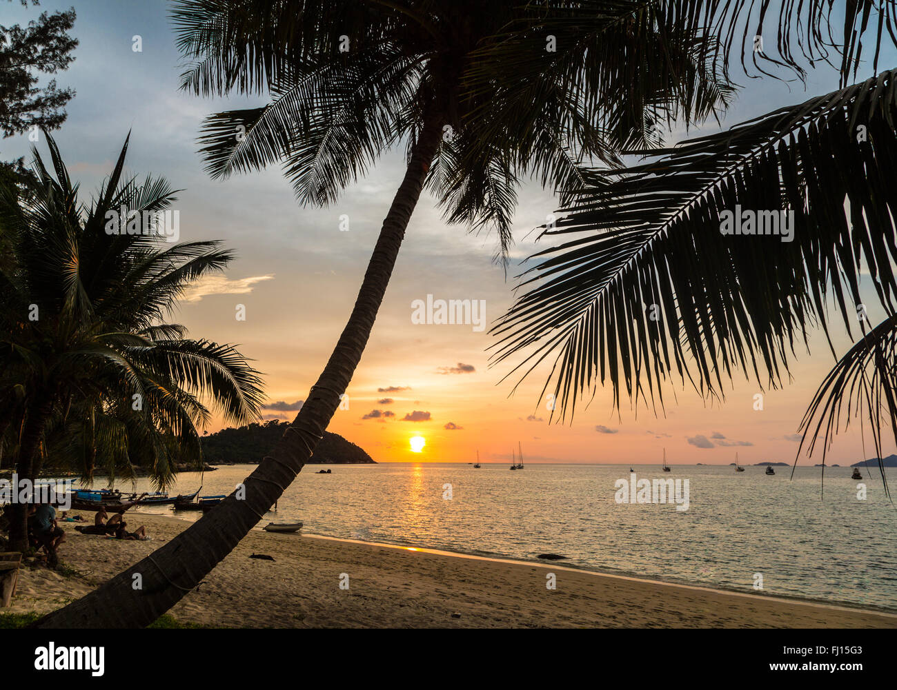 Sunset over a lonely beach in Koh Lipe island in the Andaman sea in south Thailand. - Stock Image