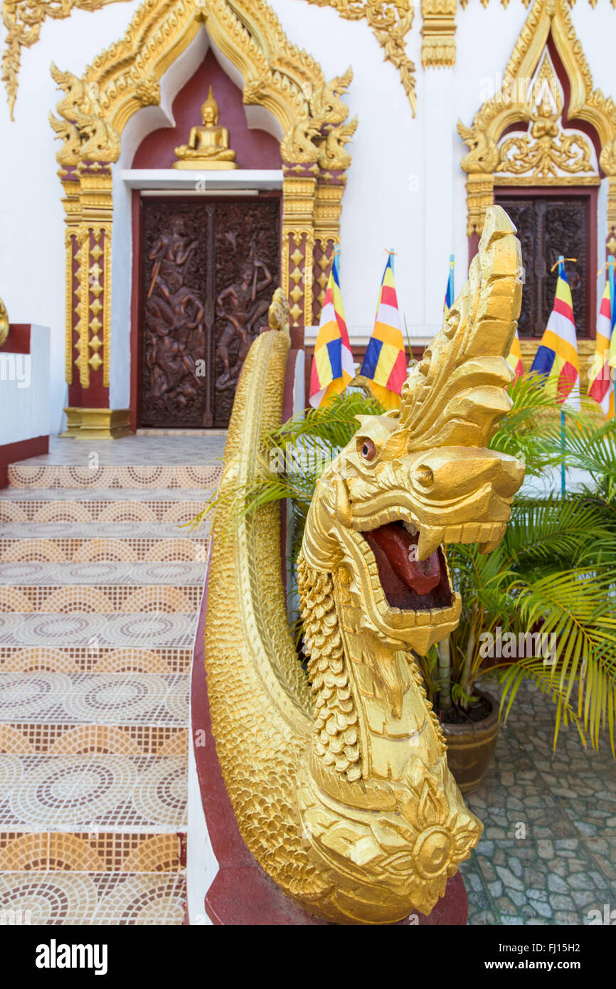 A Naga, the holy snake, at the entrance of the Wat Luang Pakse, which is a ancient Buddhist temple in Pakse in south - Stock Image
