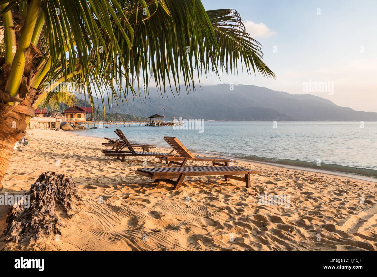 Long chairs on a beach in Pulau Tioman, Malaysia - Stock Image