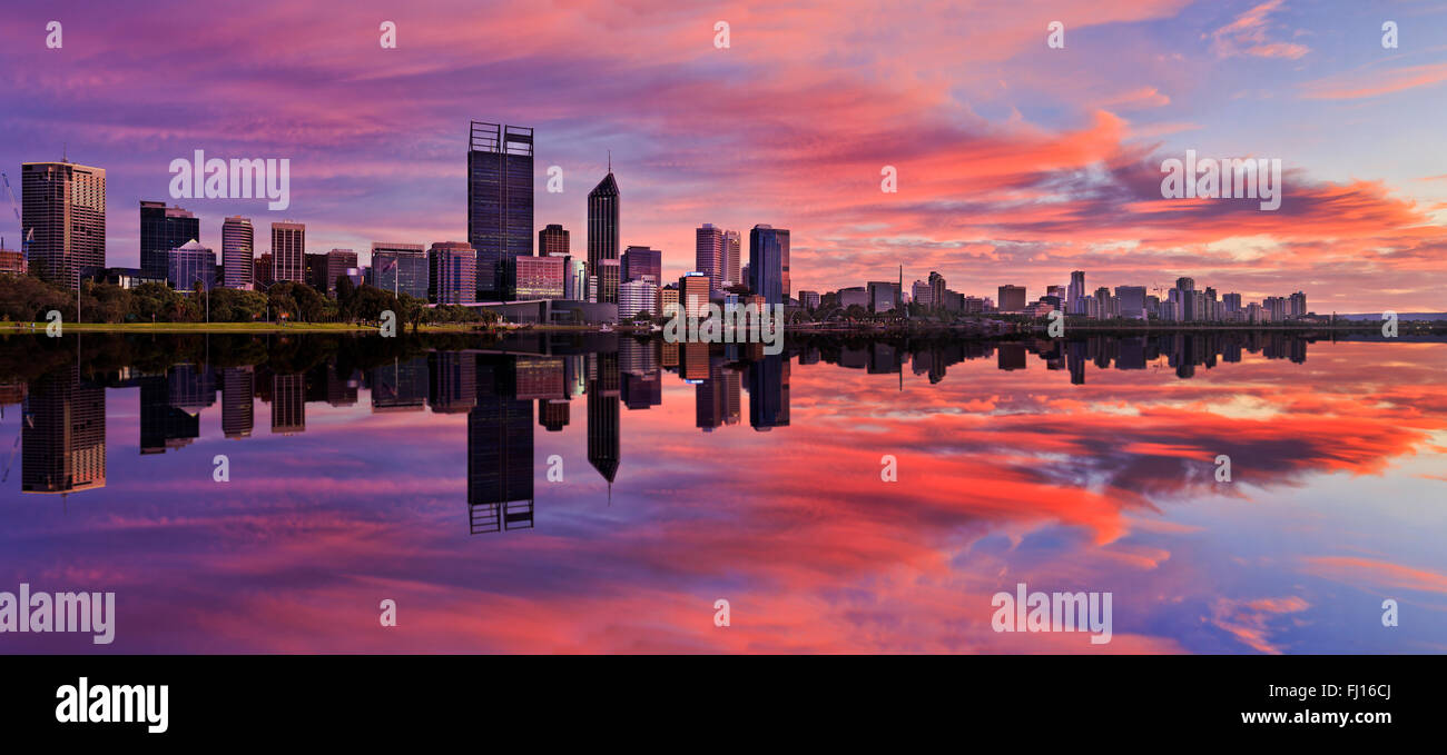 still reflection of Perth Western Australian capital at sunrise in calm waters of Swan River. Horizontal panorama - Stock Image