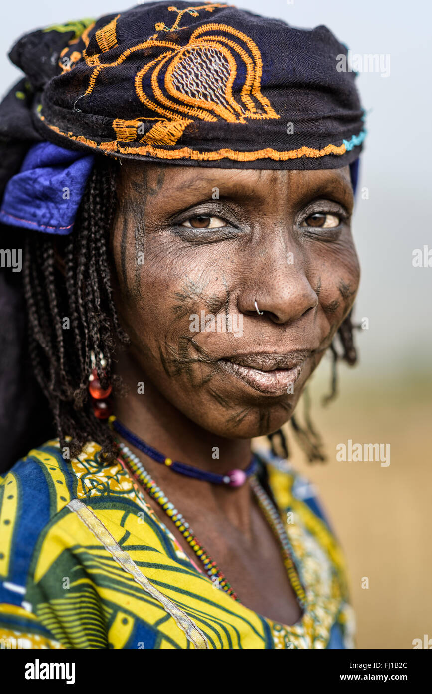 Portrait of a Mbororo woman from Cameroon with the typical scarification of this tribe on her face. - Stock Image