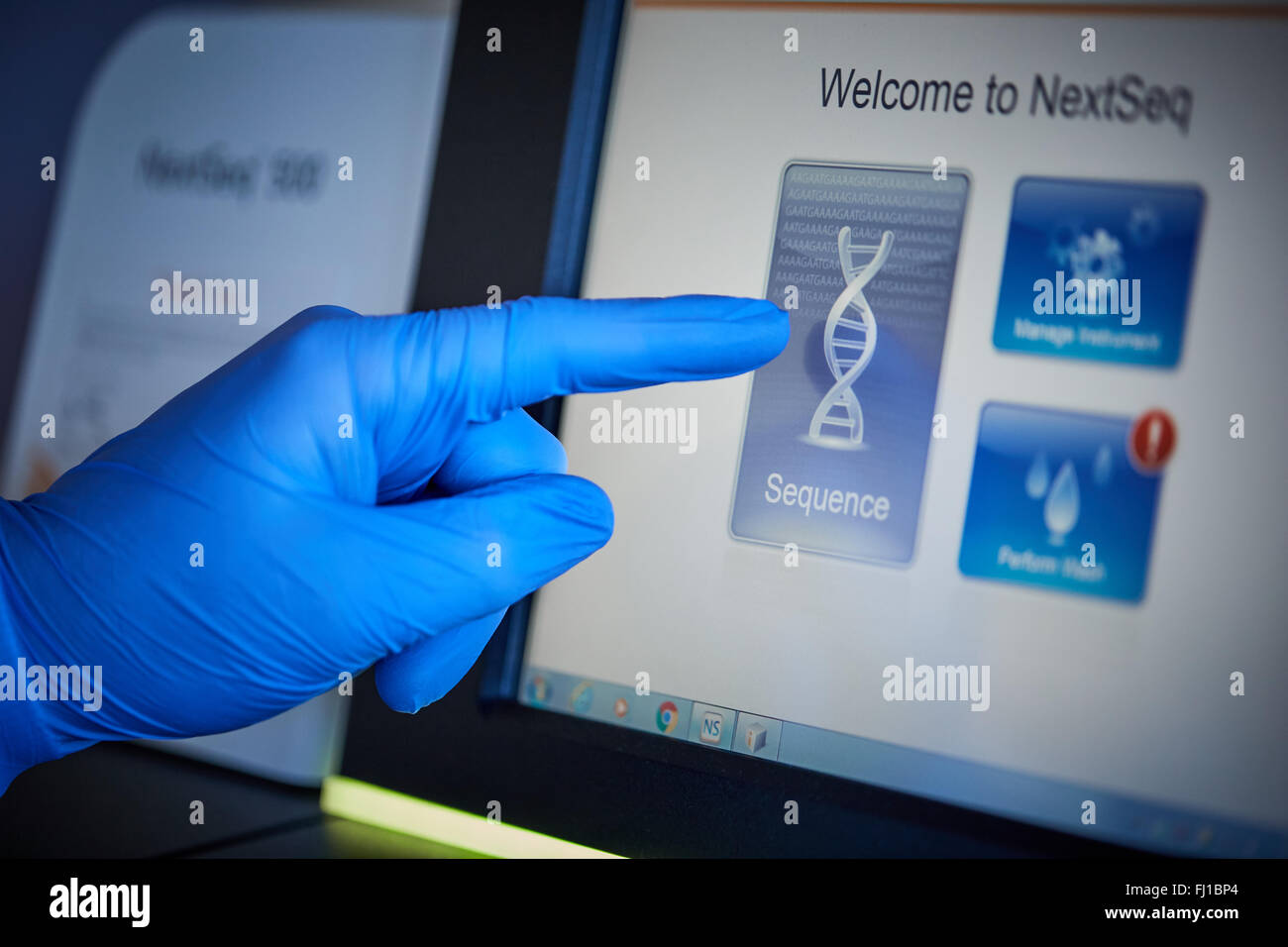 DNA testing in laboratory    Central Manchester University Hospital NHS clinic testing slide Deoxyribonucleic acid - Stock Image