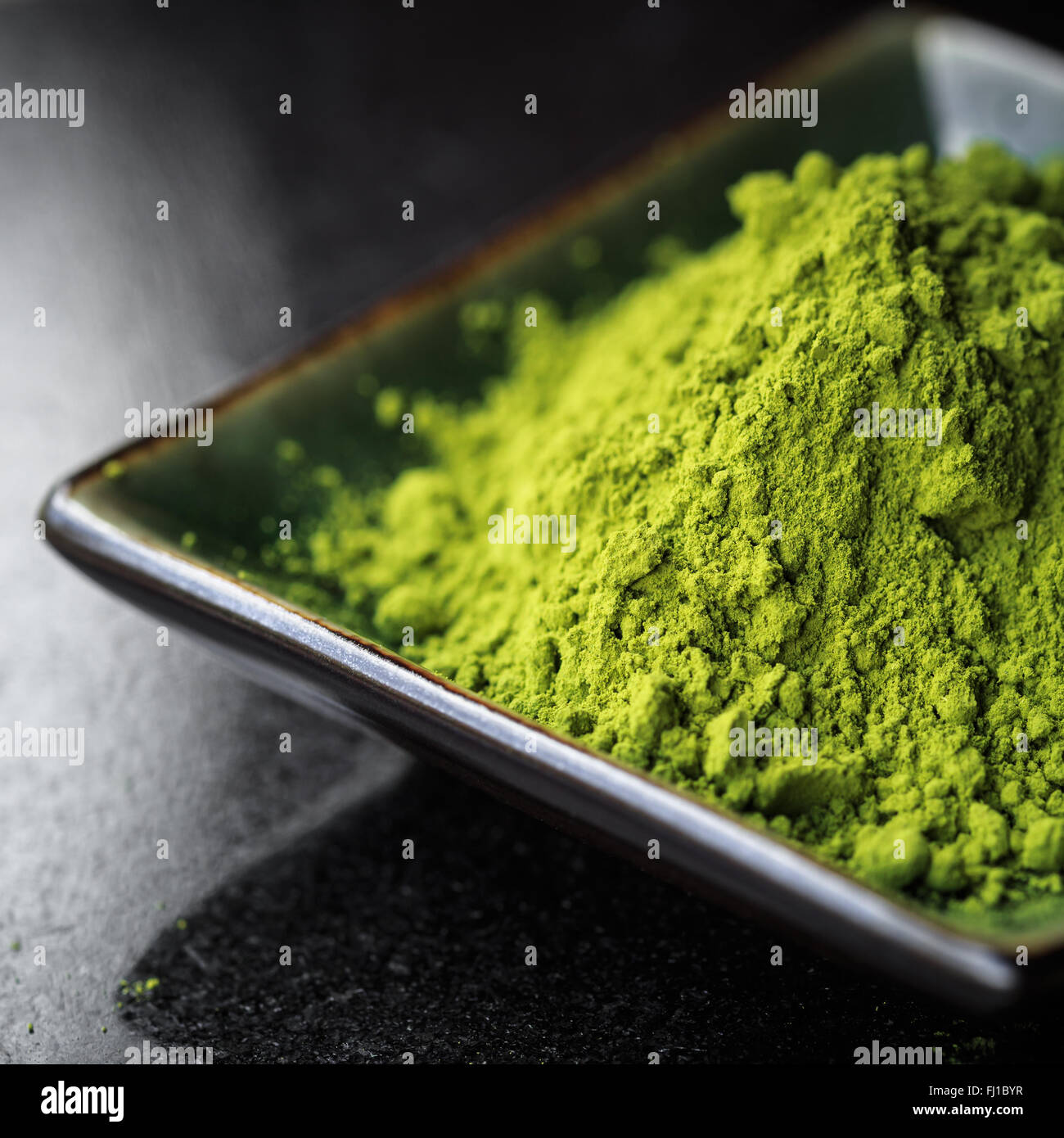 Matcha tea in a bowl - Stock Image