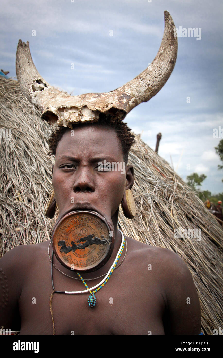 Stunning portrait of Mursi woman with lip plate , Mago National Park , Ethiopia - Stock Image