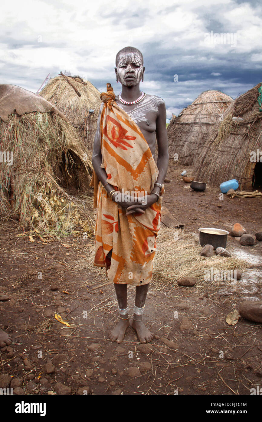 Stunning portrait of Mursi woman in front of her house , Mago National Park , Ethiopia - Stock Image