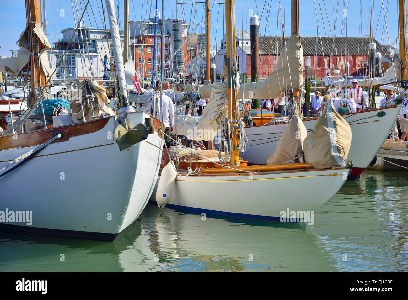 Beautiful wooden traditional classic yachts moored in Cowes marina after racing during Classic Week, Cowes, Isle - Stock Image