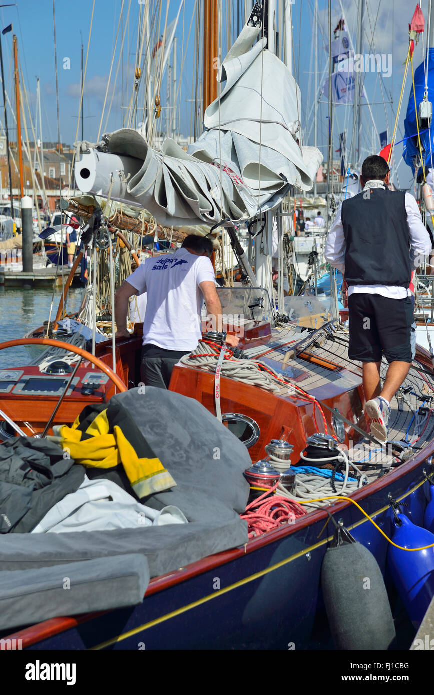 Traditional wooden classic yacht in an untidy state having returned from racing  during Classic Week, Cowes, Isle - Stock Image