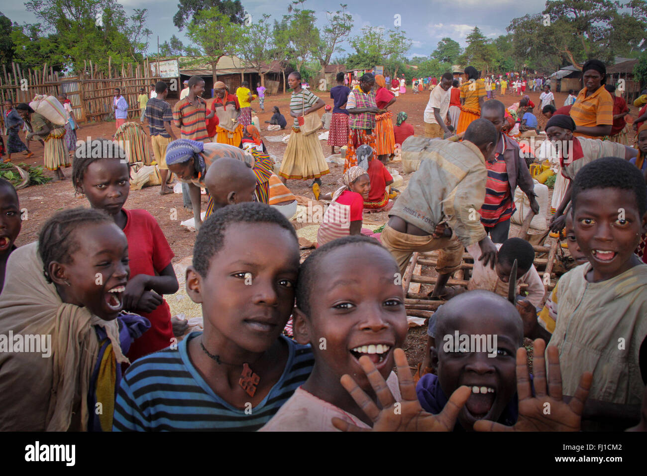 Happy crazy kids in the daily market of Konso , Ethiopia - Stock Image