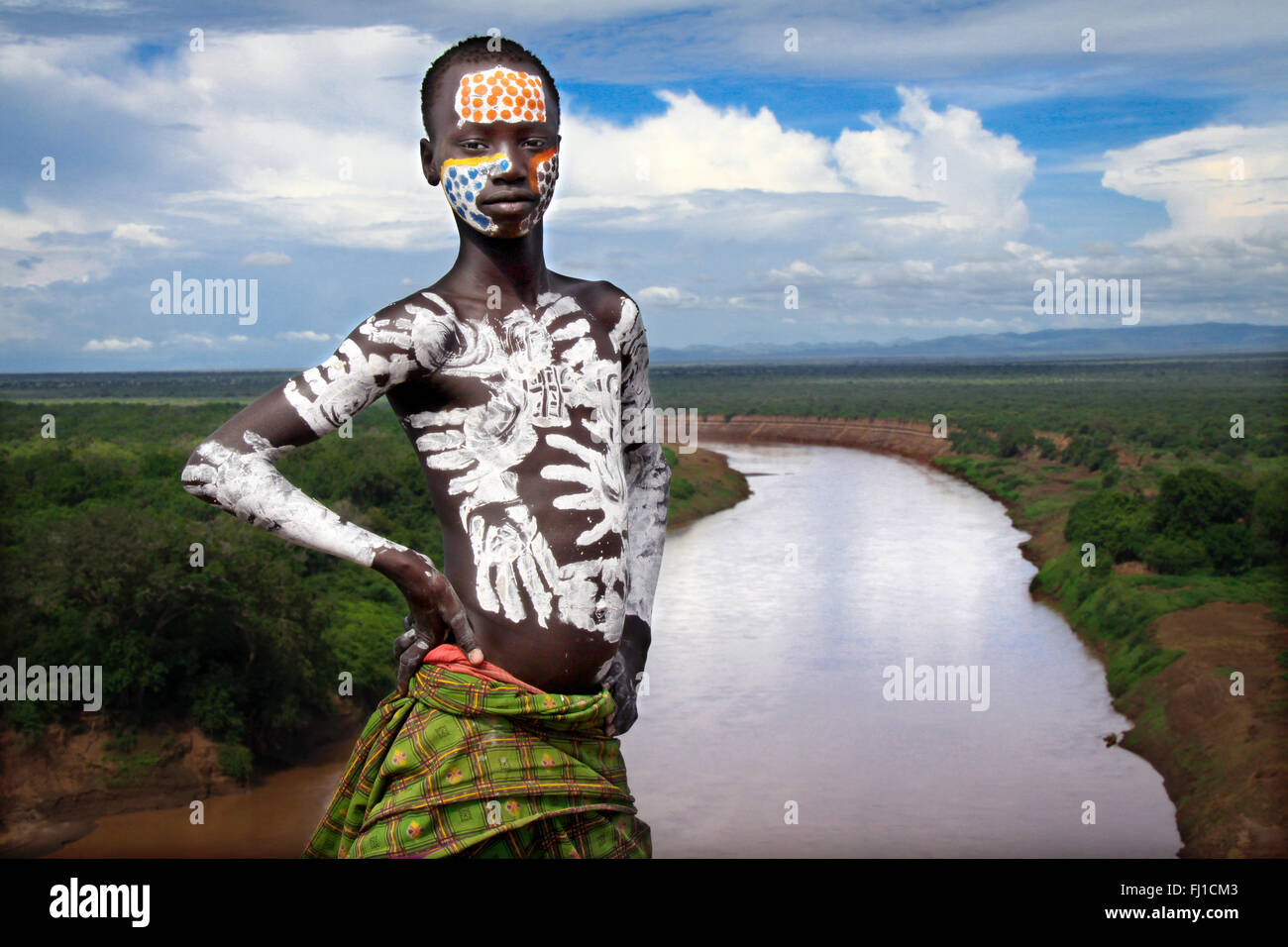 Karo young man with body painting,  posing in village in front of Omo river in Omo valley , Ethiopia - Stock Image