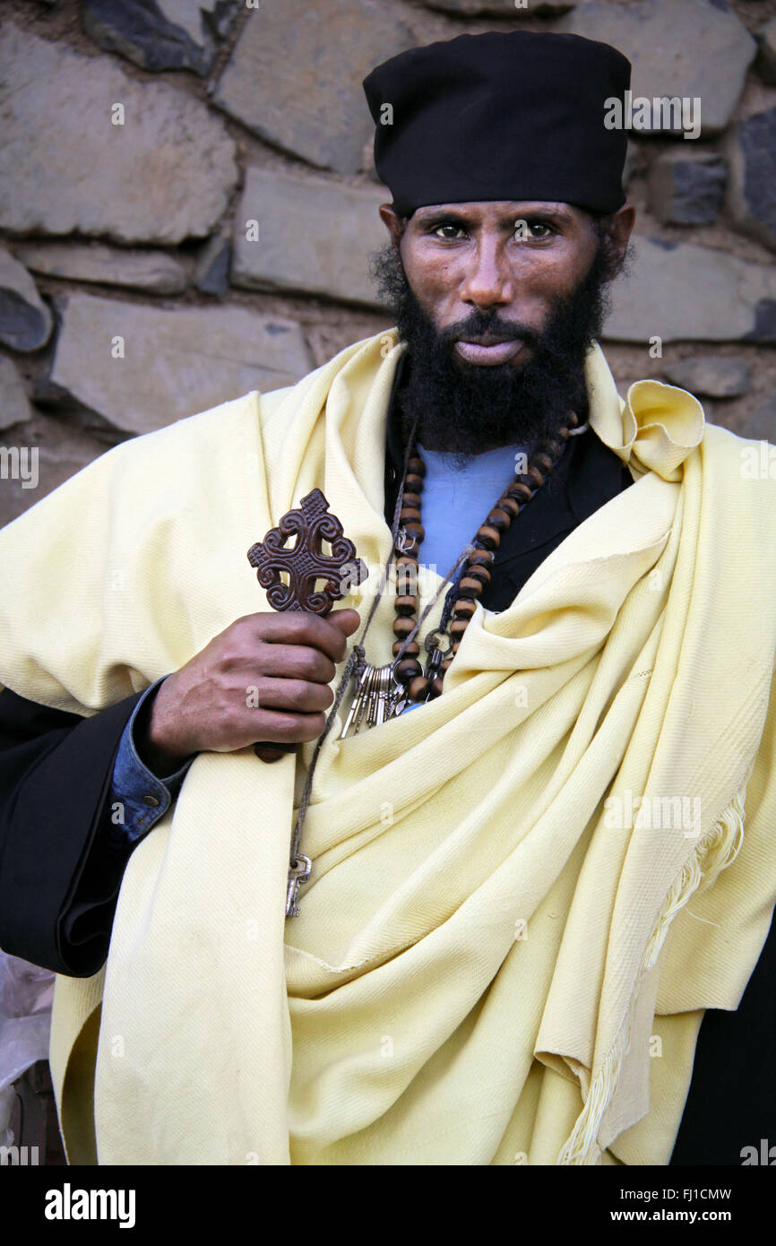 Portrait of Orthodox priest with cross in Gonder , Ethiopia - Stock Image