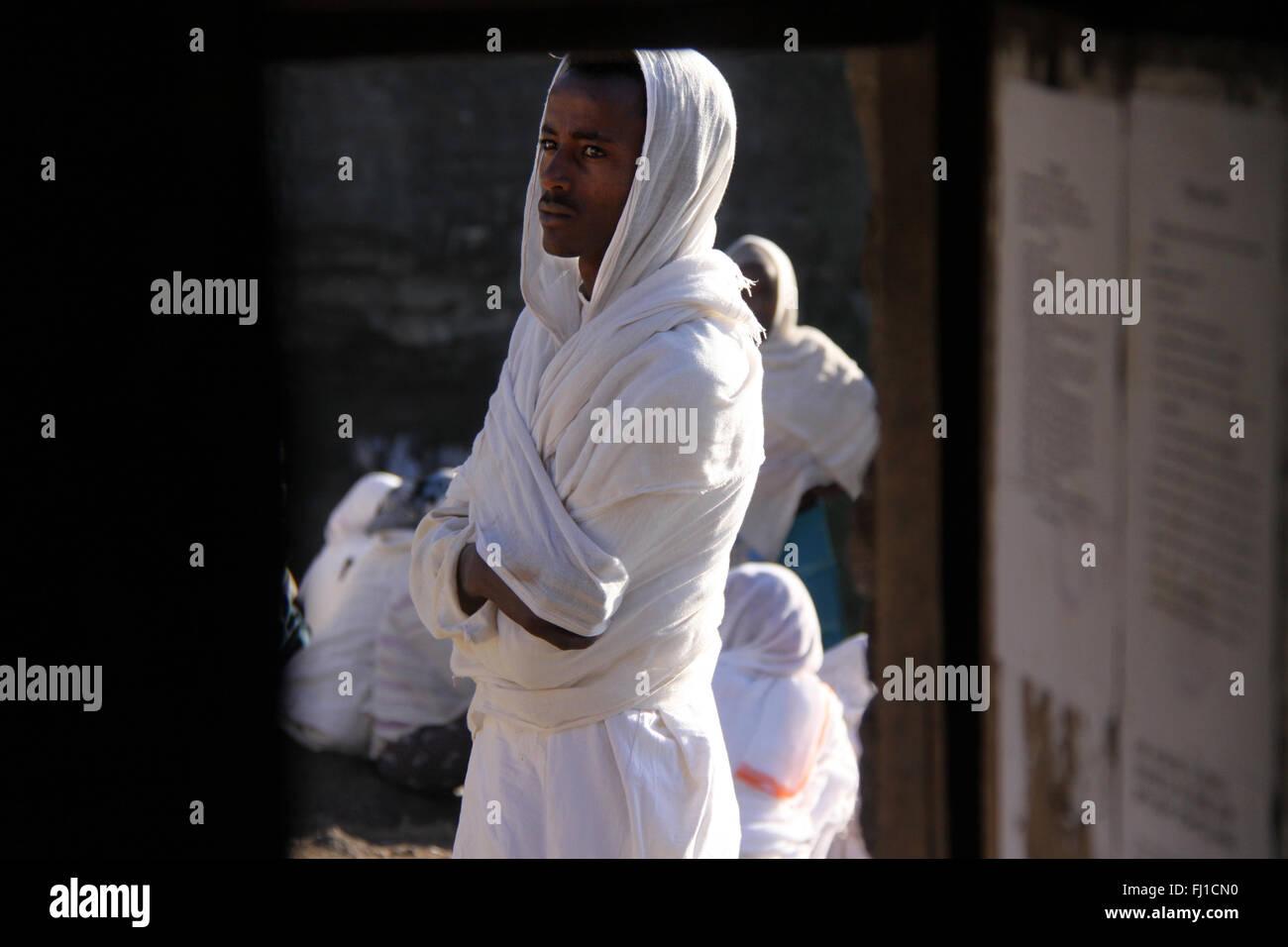 Single Ethiopian man during orthodox ceremony at Nakuta La'ab Monastery , near lalibela , Ethiopia Stock Photo