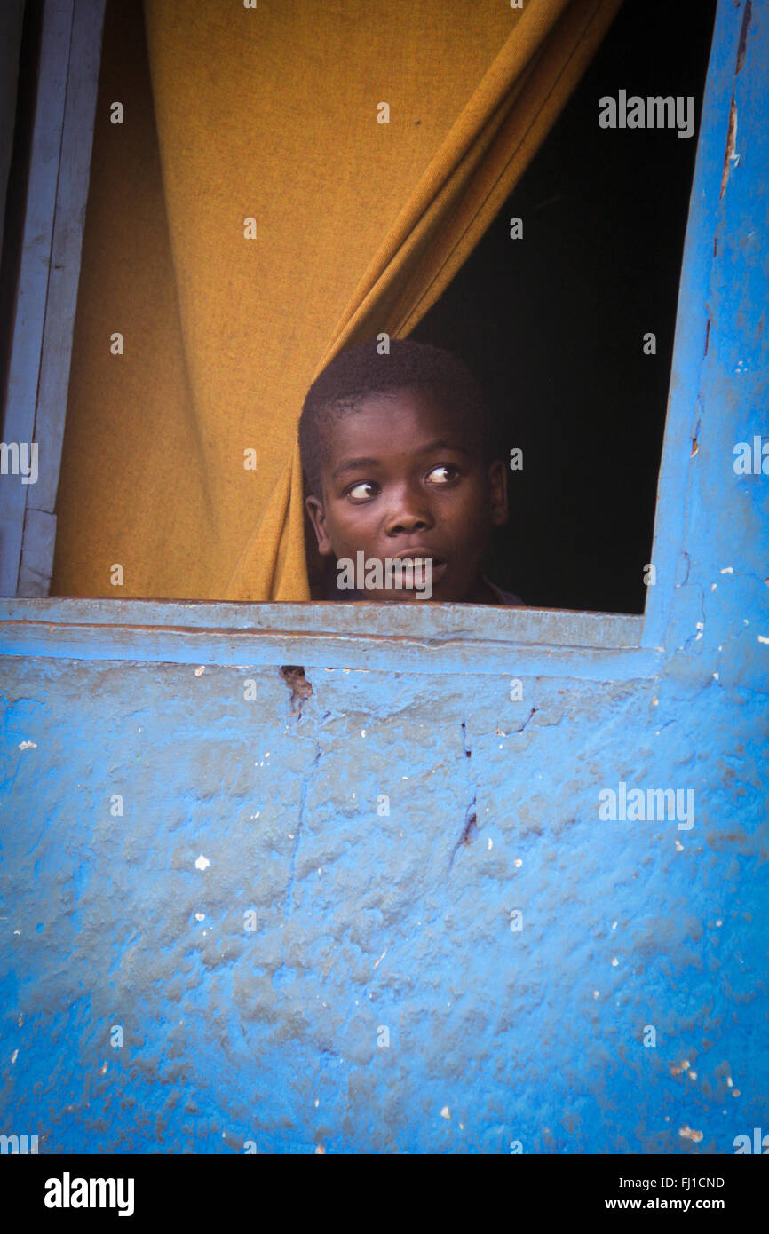 Black African Child Looks Through A Window With Blue Wall In Jinka Stock Photo Alamy