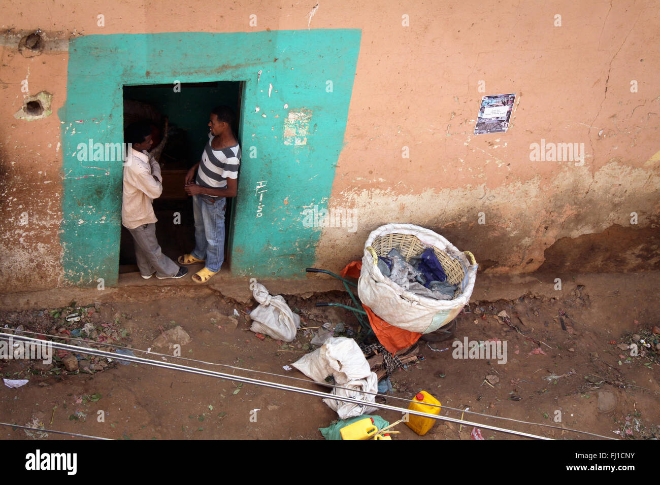 Two men are talking in Harar old city , Ethiopia - Stock Image