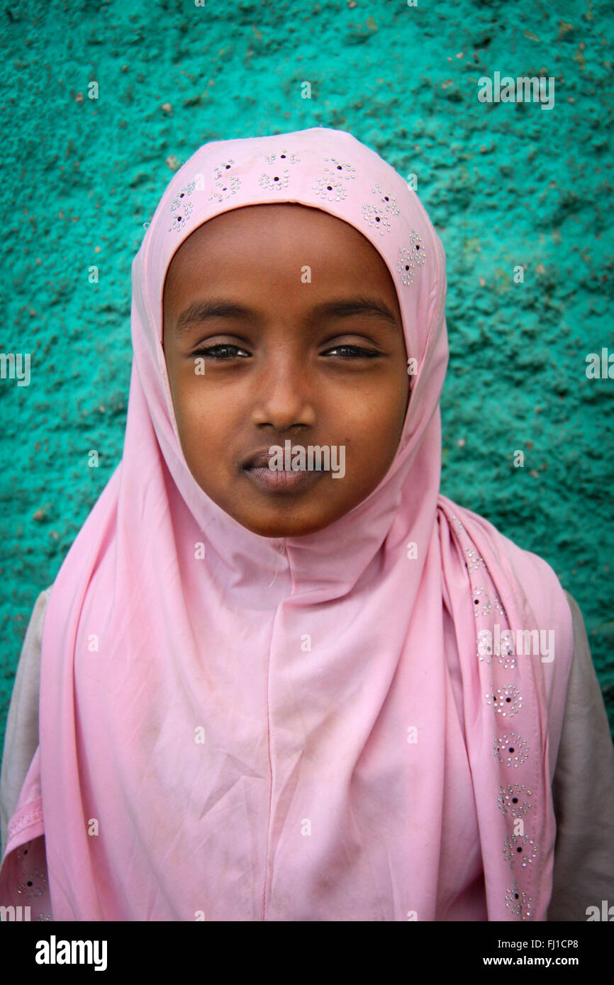 Cute Muslim girl with traditional pink hijab in Harar , Ethiopia - Stock Image