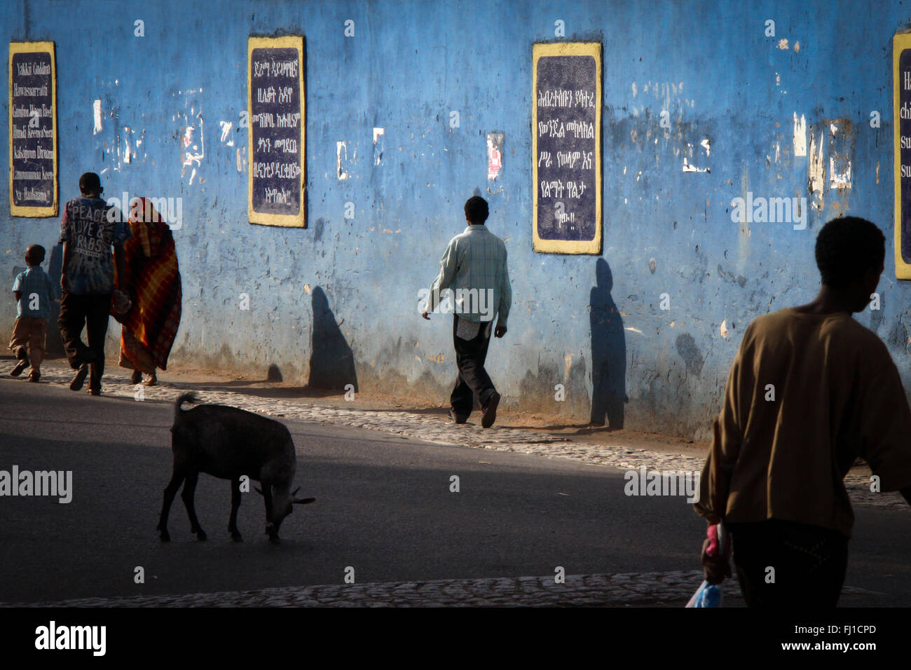 people walk in the old city of Harar , Ethiopia , with its stunning architecture - Stock Image