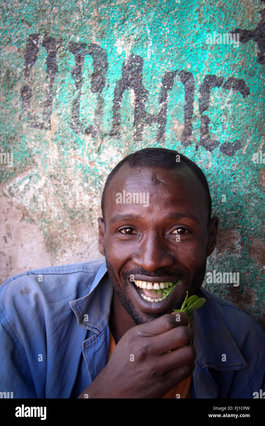 Man chewing  in Khat Harar, Ethiopia - people, architecture and streetlife - Stock Image