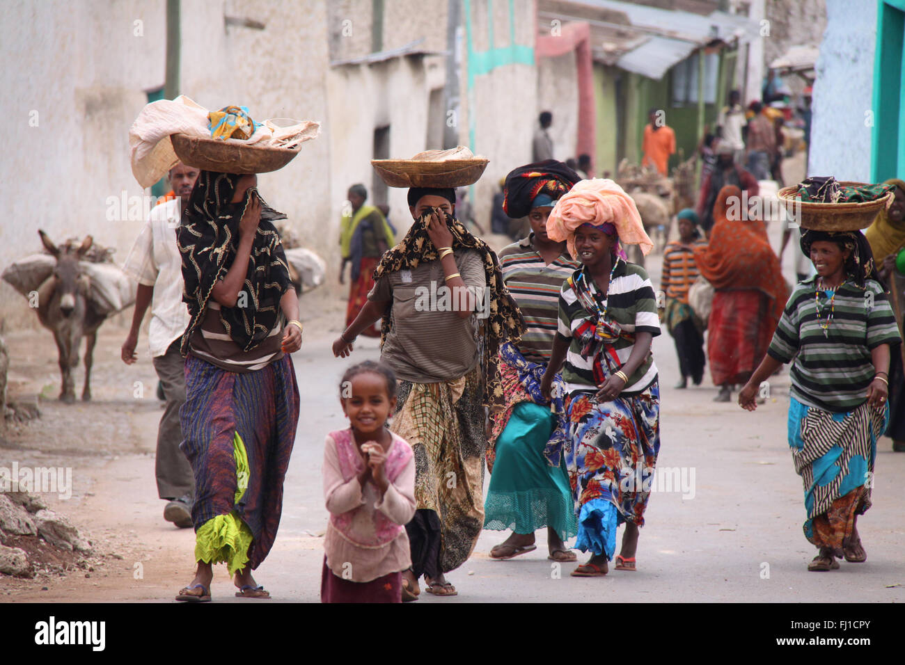 Group of women walking in a street of Harar , Ethiopia - Stock Image