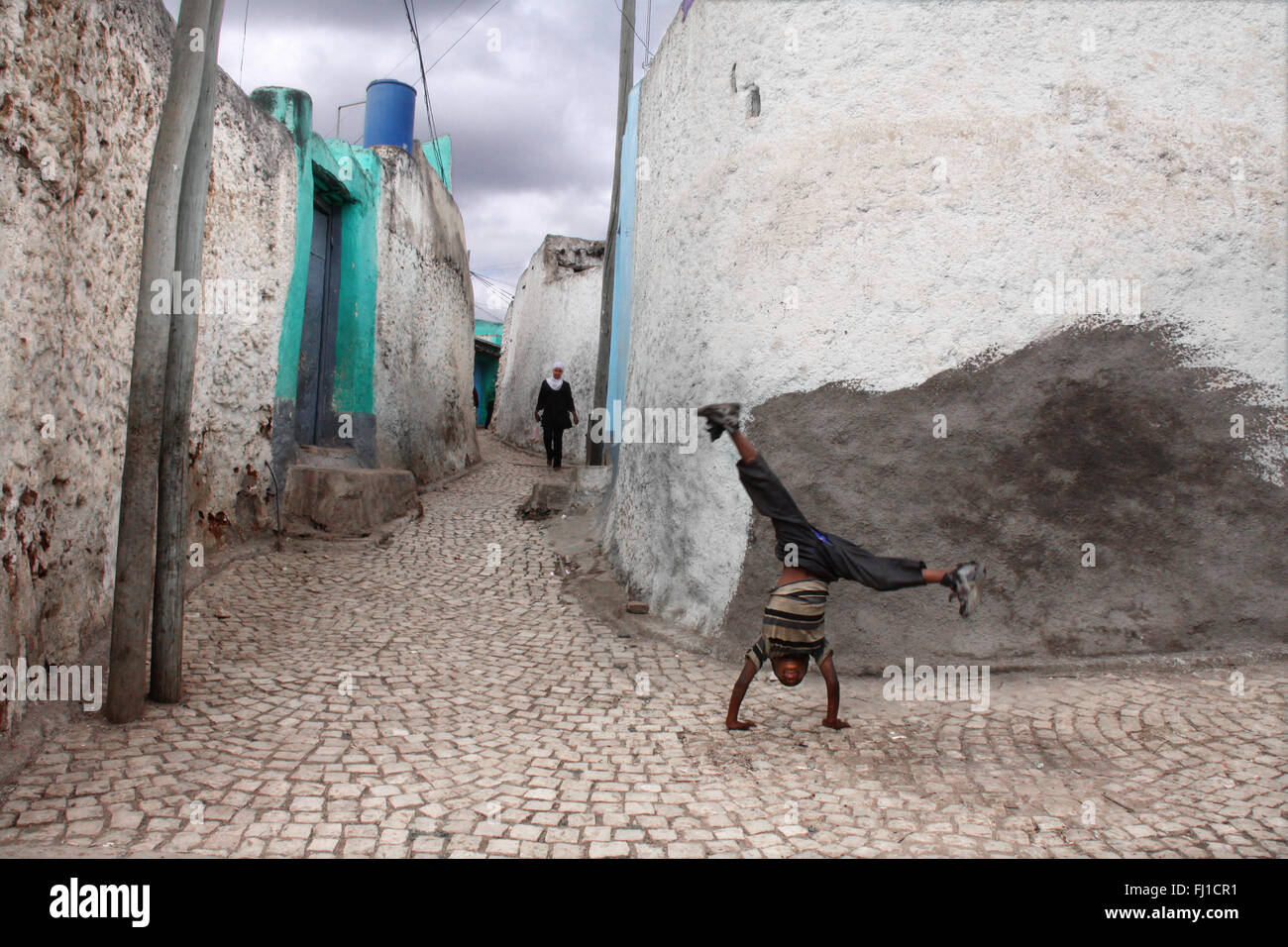 A Kid is playing in a street of the old city of Harar , Ethiopia - Stock Image