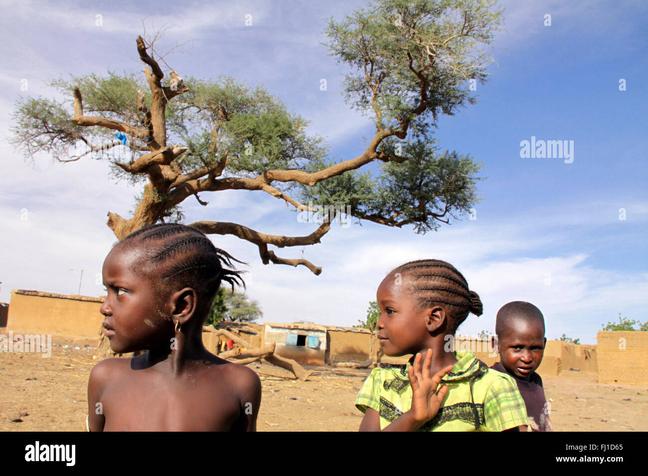 Portrait of girls with braids in Burkina Faso - Stock Image