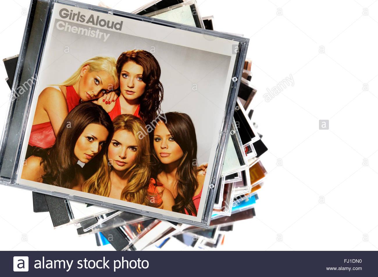 Girls Aloud 2005 album Chemistry, piled music CD cases, Dorset England - Stock Image