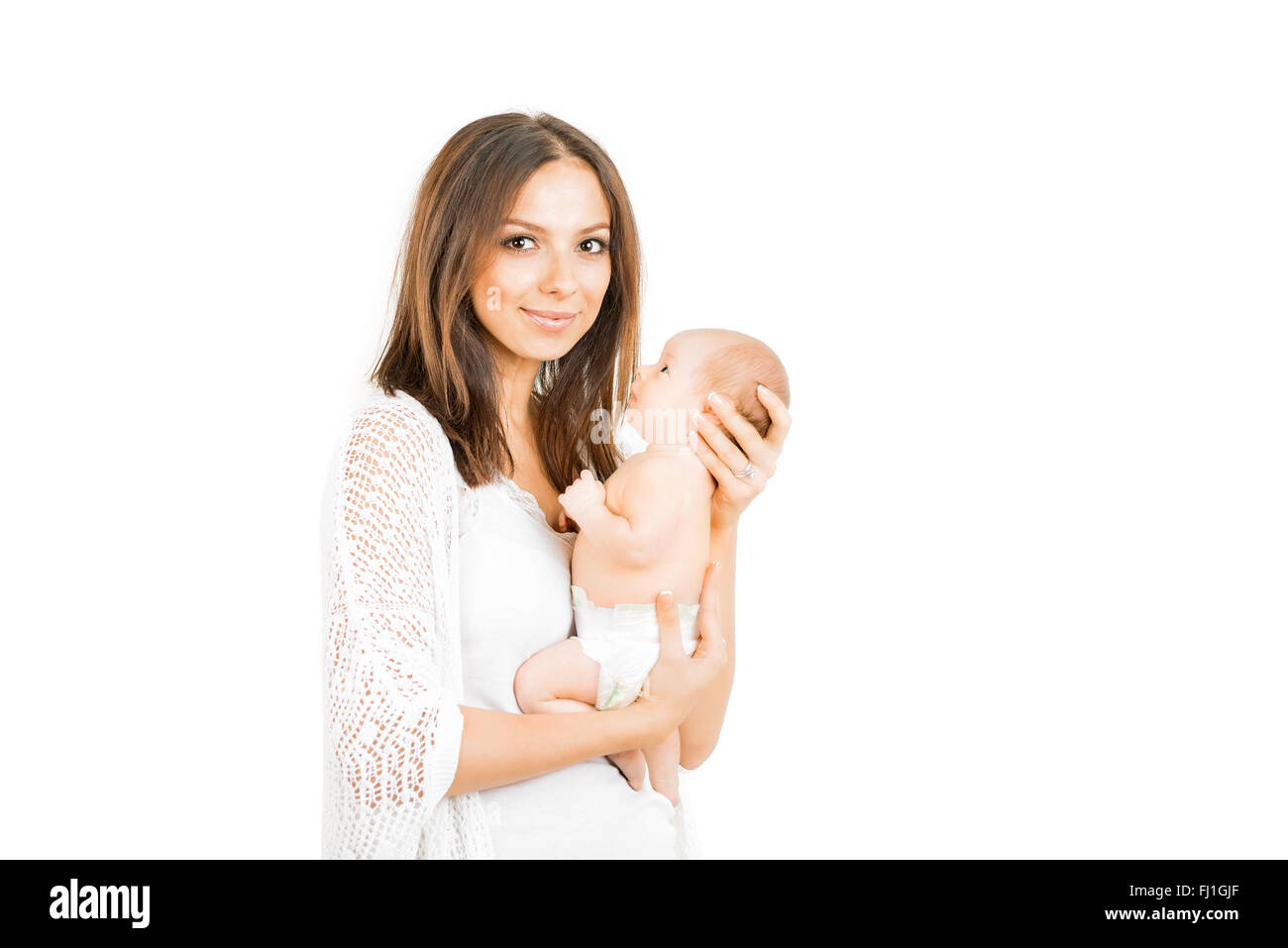 Happy mother with  newborn baby   girl isolated - Stock Image