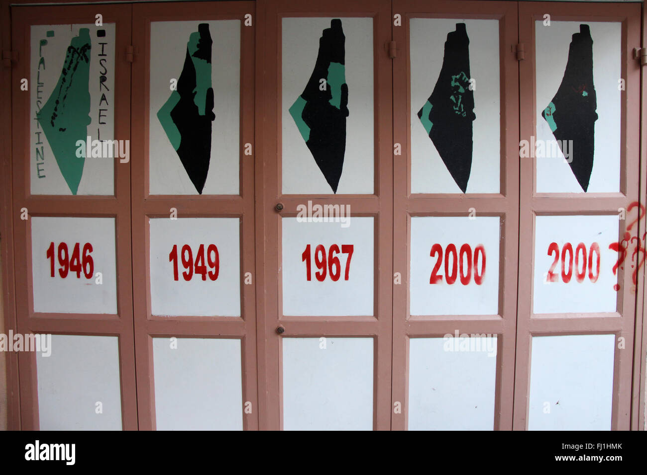 The evolution of Israeli progression in the Palestinian territories is painted on a wall at the Dheisheh refugee - Stock Image