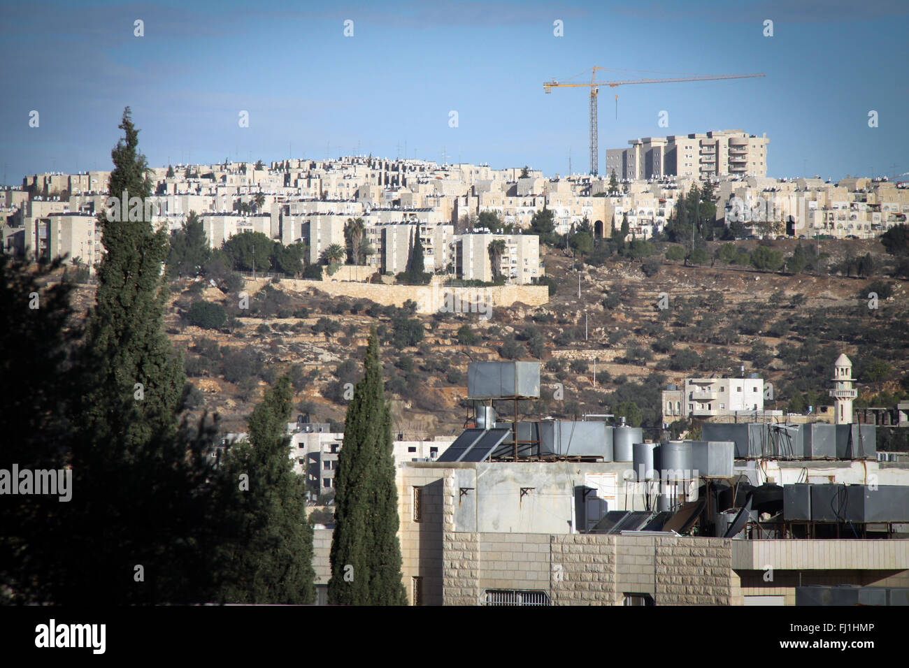 Constructions of Jewish Israeli Settlements and buildinds seen from Bethlehem - Palestinian occupied territories - Stock Image