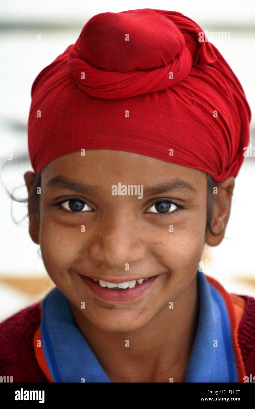 a90d9f5d Punjabi Sikh kid child boy wearing red turban in Amritsar , India - Stock  Image