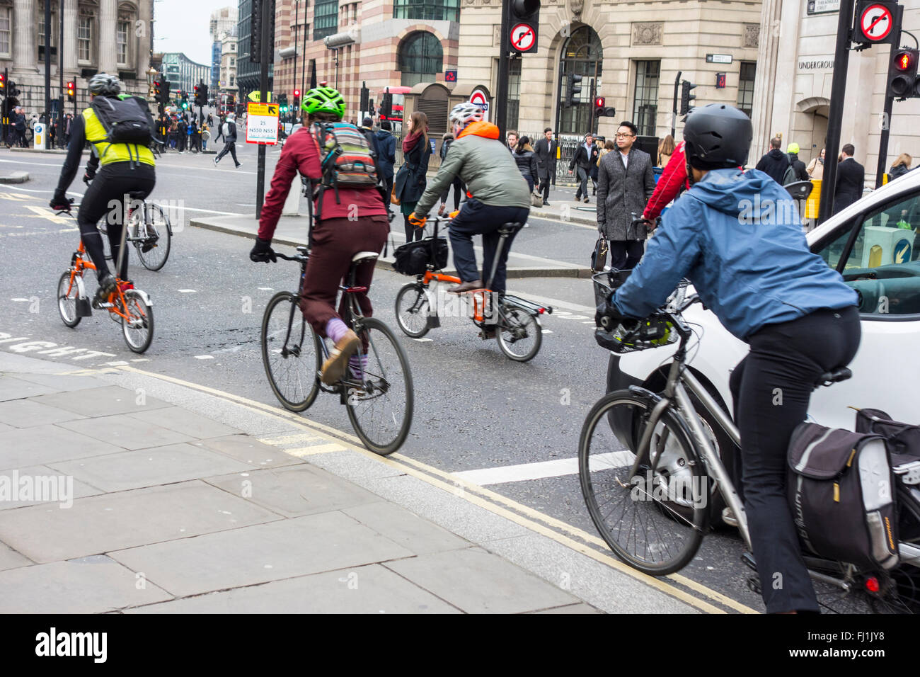 Cyclists setting off from traffic lights at Bank junction, London, UK - Stock Image