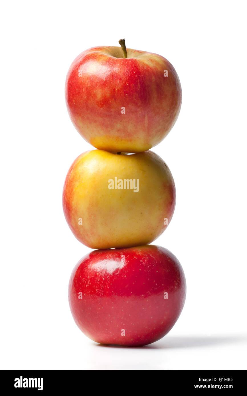 Three fresh whole Elstar apples on white background - Stock Image