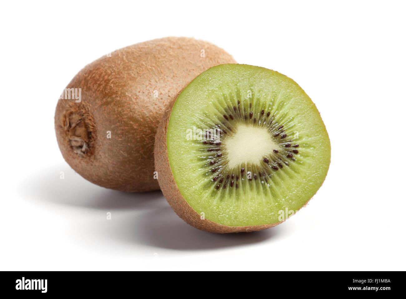 Fresh ripe one and a half kiwi on white background - Stock Image