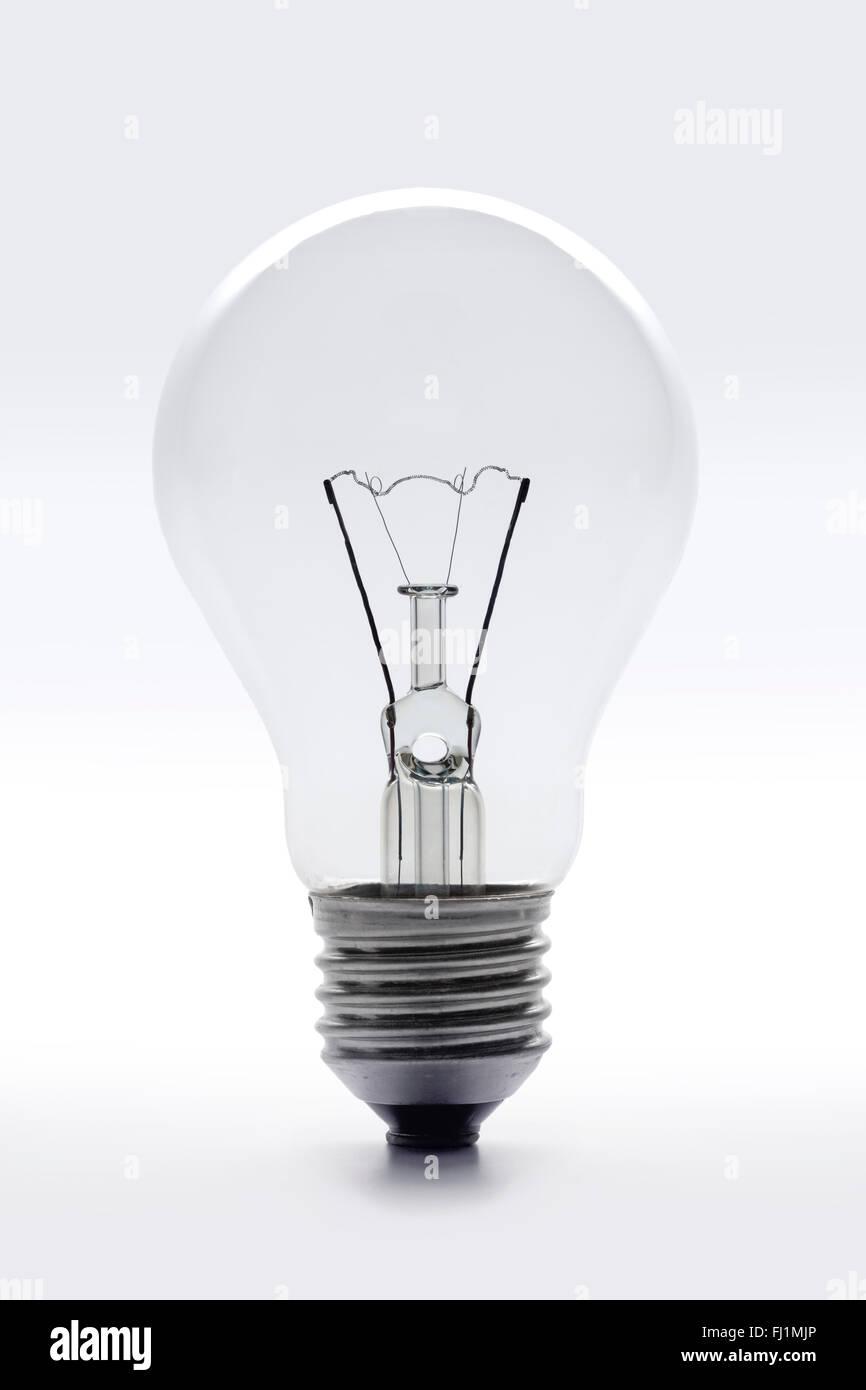 Clear lightbulb on white background - Stock Image