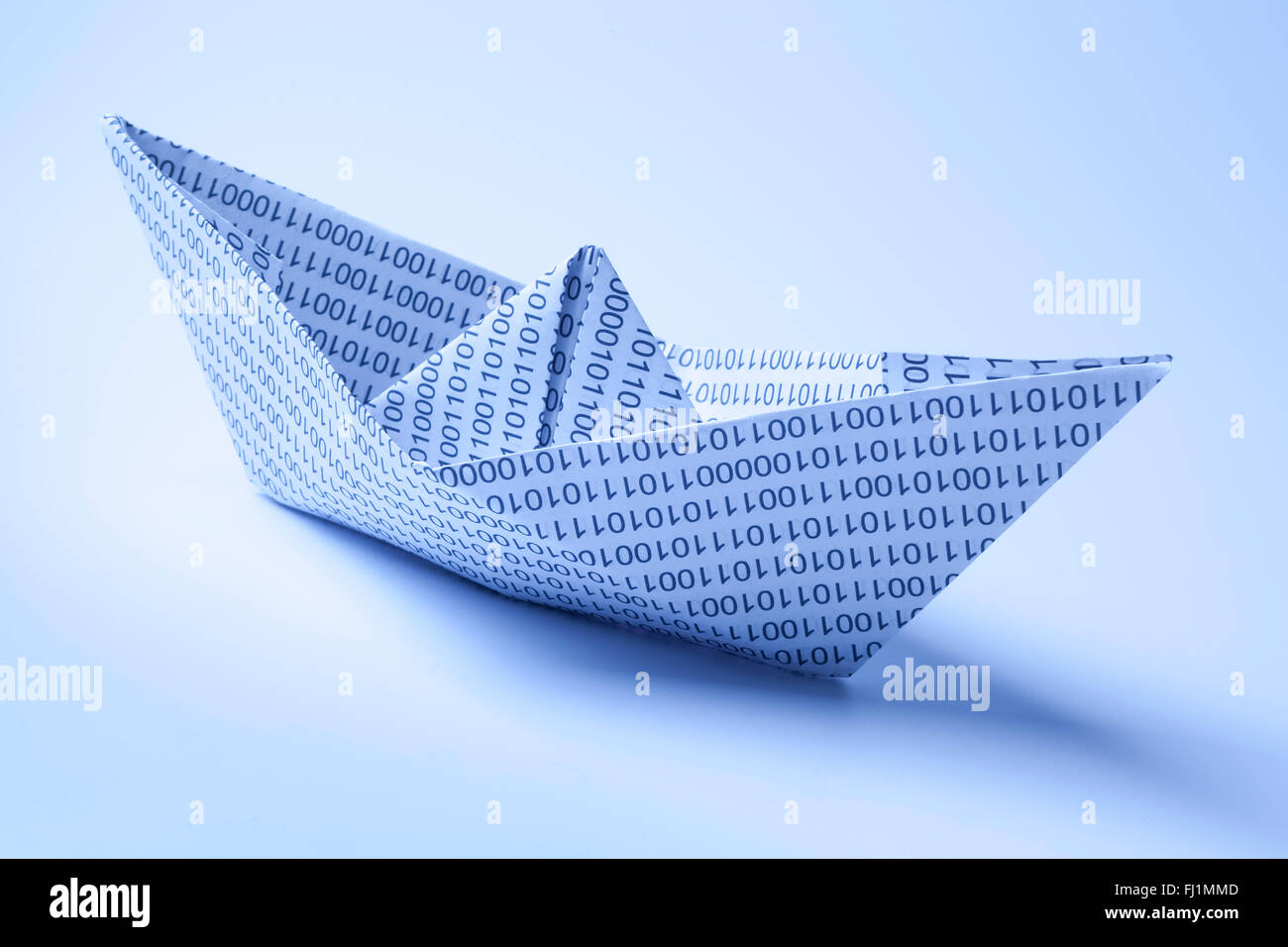 Paper ship with zero and ones - Stock Image