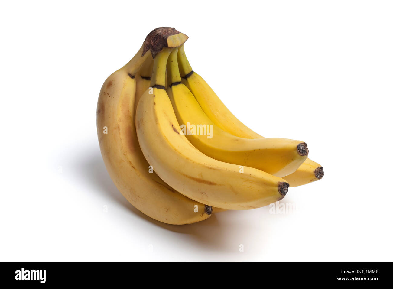 Bunch of unpeeled bananas on white background - Stock Image