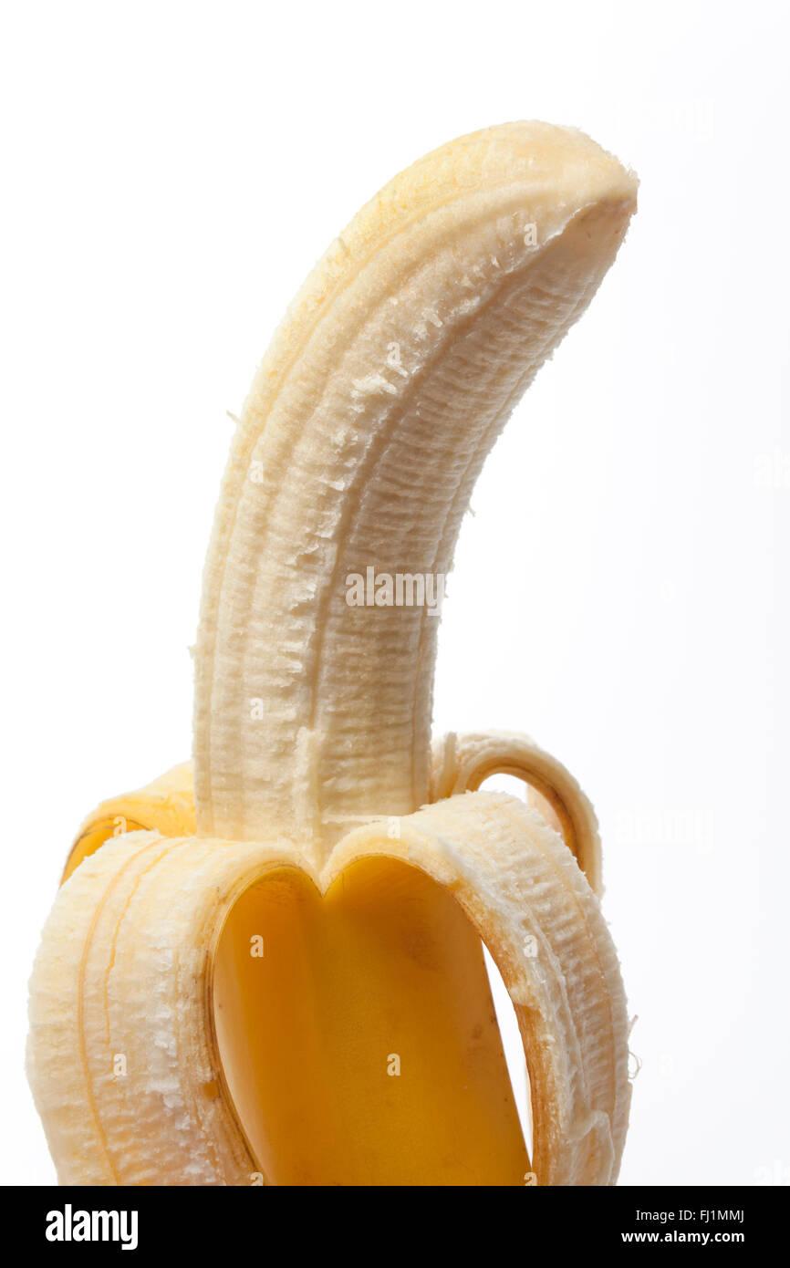 Peeled banana with a skin on white background - Stock Image