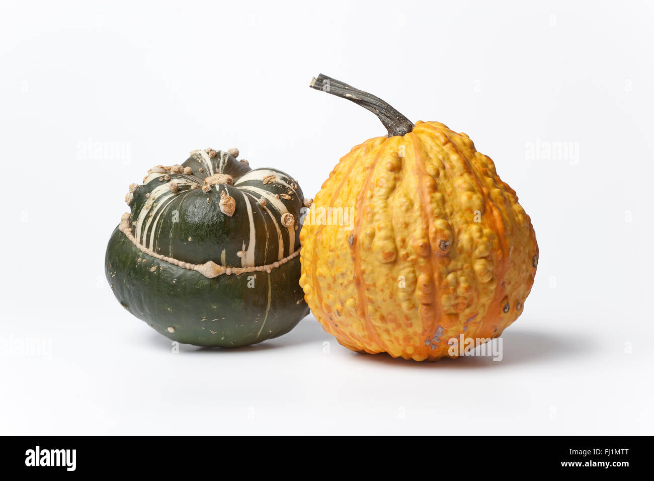 Two decorative pumpkins on white background - Stock Image