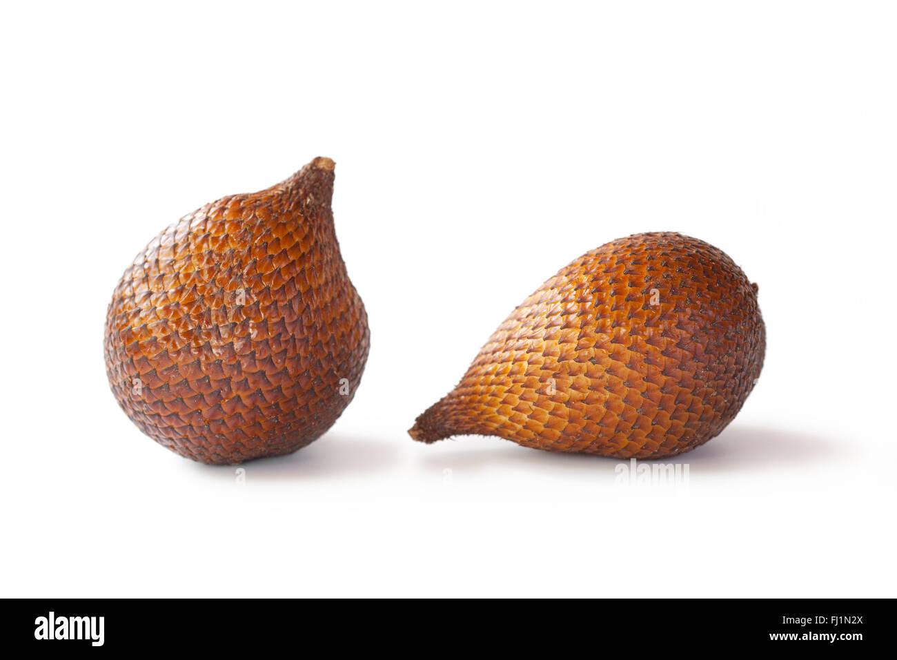 Two fresh whole snakefruit on white background - Stock Image