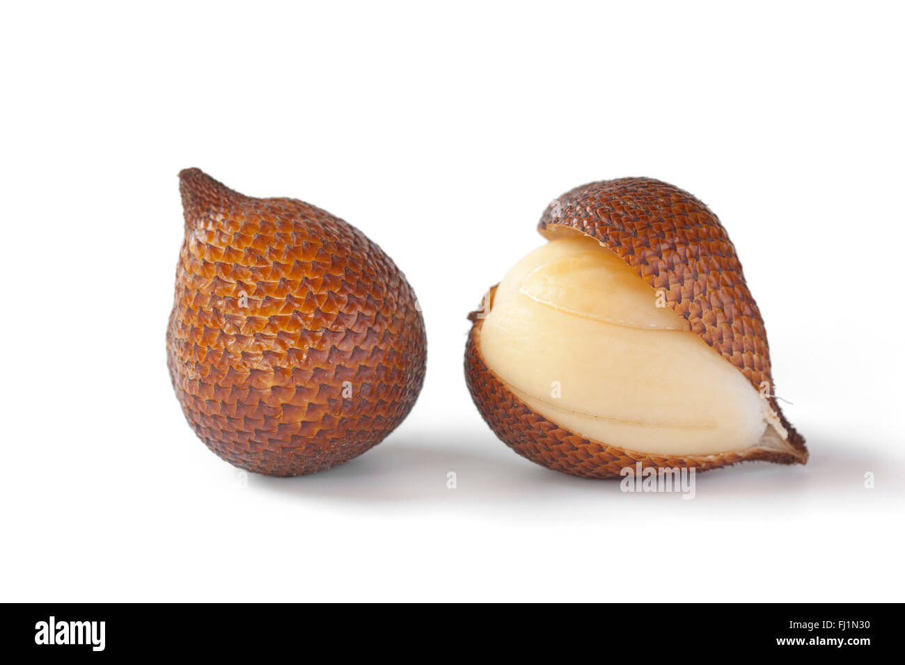 Fresh whole and peeled snakefruit on white background - Stock Image