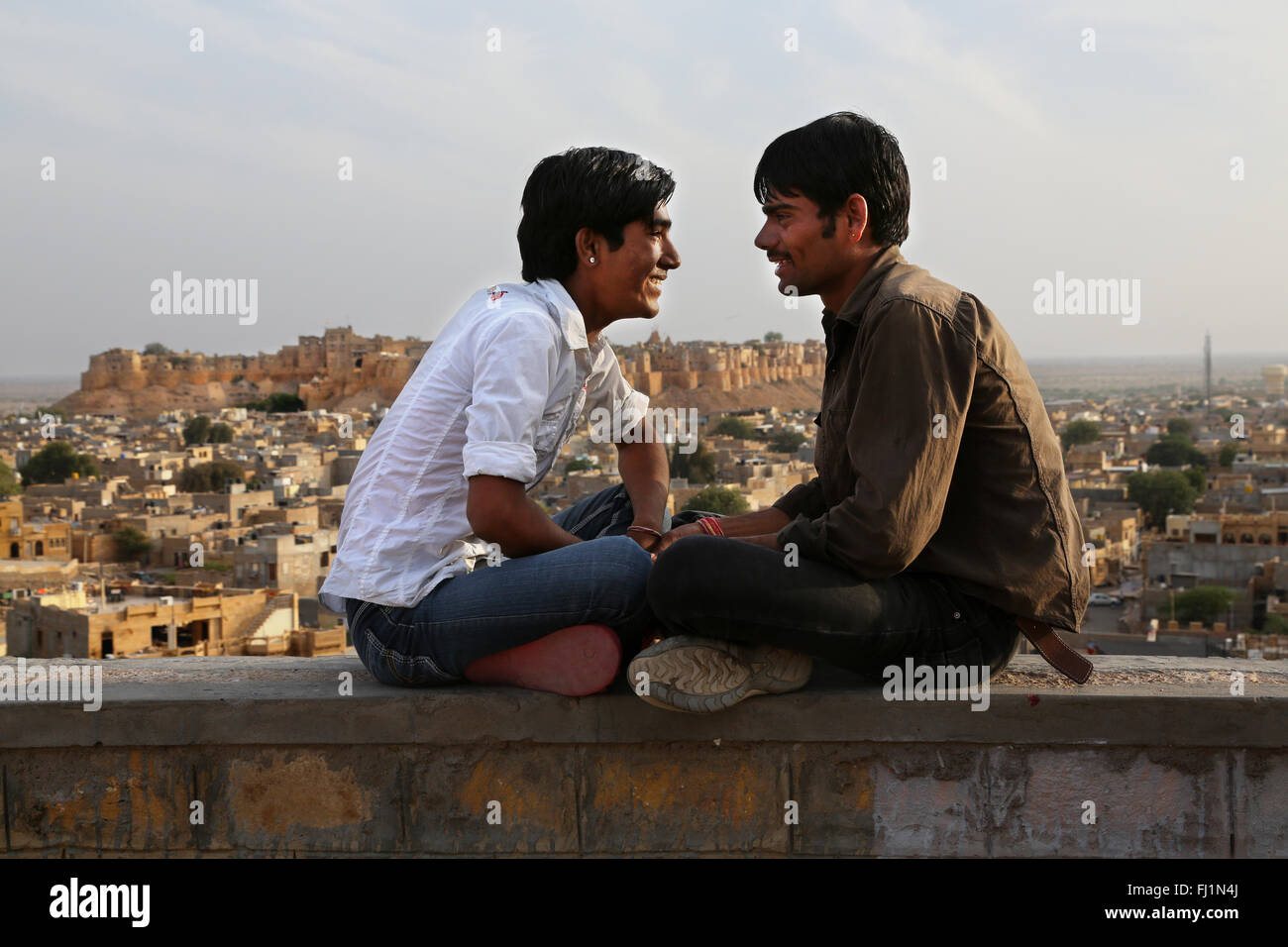 Two men are looking at each other in Jaisalmer , India - Stock Image