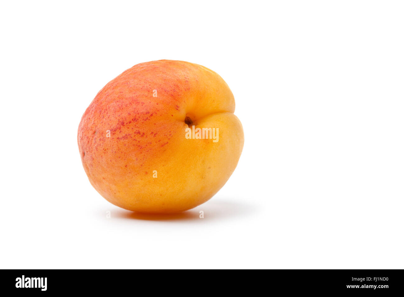 Whole fresh apricot isolated on white background - Stock Image
